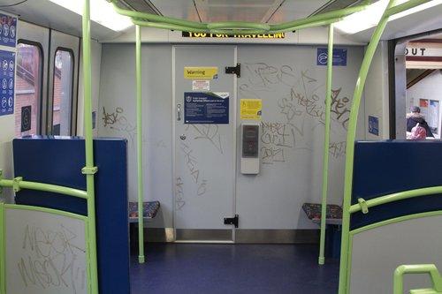 Graffiti covered bulkhead wall onboard an X'Trapolis train