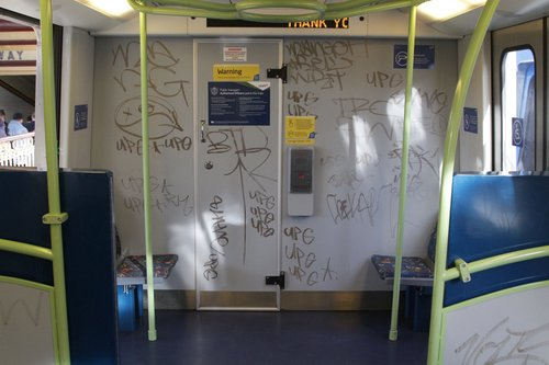 Graffiti covered bulkhead wall onboard an X'Trapolis train