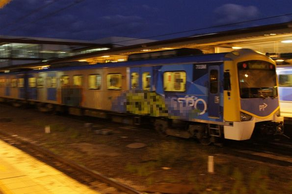 Pair of murals on the side of an in-service Siemens train at Flinders Street