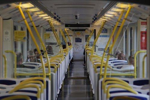 Looking down a Siemens train to a graffiti covered end bulkhead