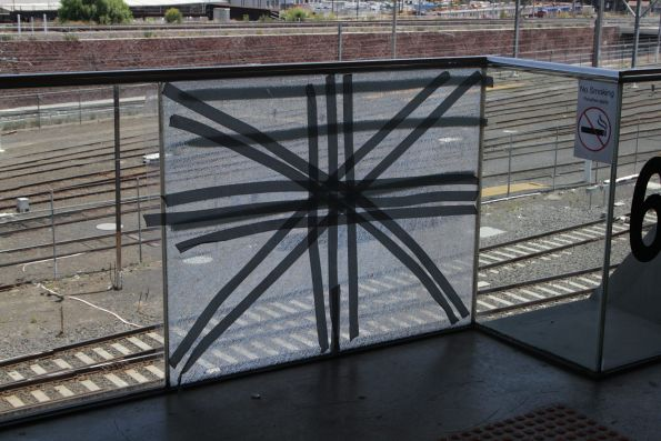 Cracked glass balustrade at North Melbourne station