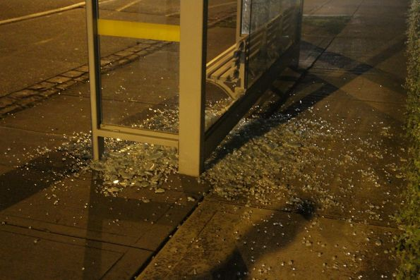 Smashed glass at a bus shelter