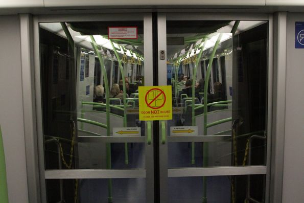 'Door not in use' sticker on the intercar communication doors of an X'Trapolis train