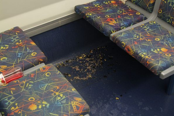 Mess on the train floor - spilt food, or spew?