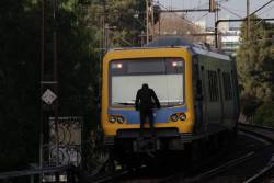 Coupler rider on the rear of a citybound train at Victoria Park