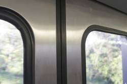 Missing rubber door window seal onboard an X'Trapolis train