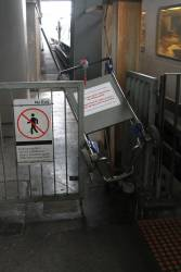 Luggage trolley jammed off the edge of a platform at Southern Cross Station