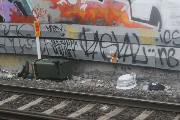 Wheelie bin thrown into the rail cutting at Footscray