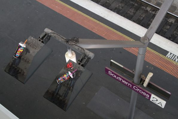 Discarded drink containers impaled on bird spikes at Southern Cross Station