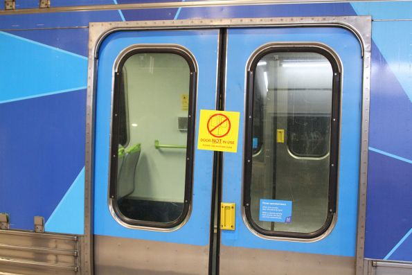 'Door not in use' sticker on a Comeng train