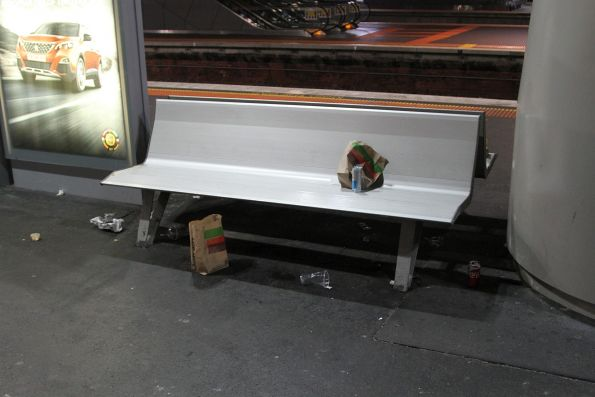 Piles of take away food rubbish litters the platform at Southern Cross Station