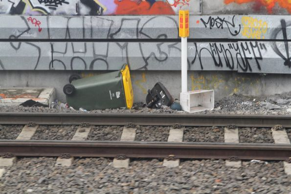 Wheelie bin down at the bottom of the railway cutting at Footscray