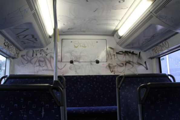 Interior of a Transdev bus covered with graffiti