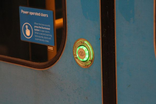 Yellow bezel missing from a Siemens train door open button
