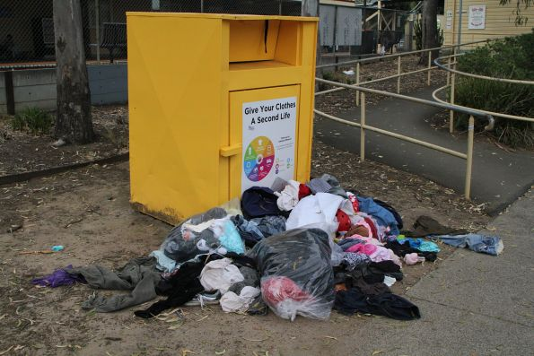Clothing recycling bin overflowing at Fairfield station