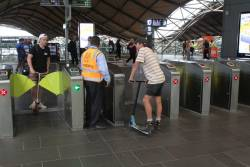 Dickhead gets pulled up by station staff after flying through the ticket gates on his scooter and almost faceplanting on the concrete floor