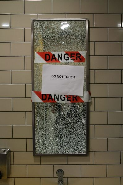 Smashed mirror in the public toilet at Sunshine station