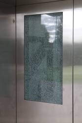 Smashed glass window at the Sunshine station lift