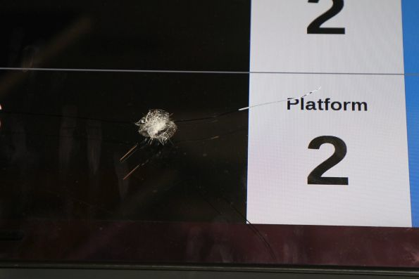 Smashed glass on the LCD next train displays at Sunshine station