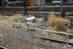 Abandoned bike and two shopping trolleys beneath the La Trobe Street bridge
