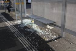 Smashed glass window at the Sunshine station bus stop