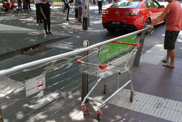 Abandoned Coles shopping trolley at the Collins and Elizabeth Street tram stop