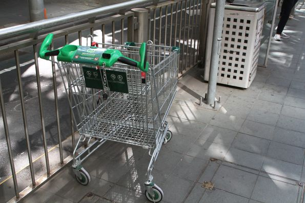 Abandoned Woolworths shopping trolley at the Collins and Spring Street tram stop