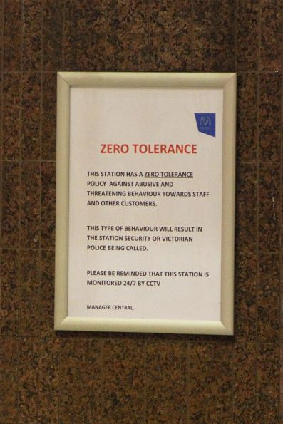 'Zero tolerance to abusive and threatening behaviour towards staff' sign at the Flinders Street Station ticket office