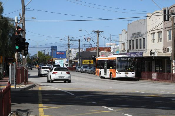 Ventura bus #1242 BS01MP northbound on route 703 along Clayton Road, Clayton