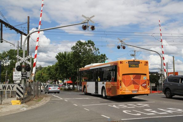 Ventura bus #992 8274AO crosses the Maroondah Highway level crossing in Lilydale