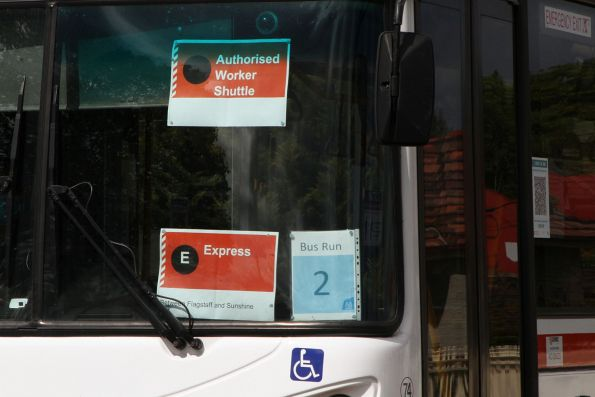'Authorised Worker Shuttle' signage in the windscreen of a rail replacement bus