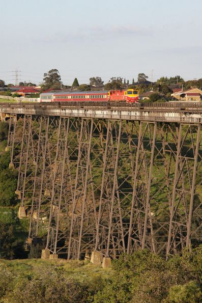 N469 leads a diverted up Shepparton train across the Maribyrnong River Viaduct