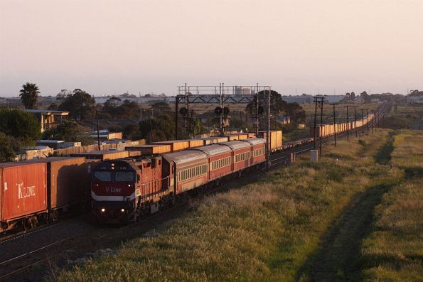 N451 finally out from behind the signal, as the freight blasts past