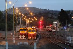 Commuter trains led by N462 and N472 still in the yard, as A66 moves into the platform at Bacchus Marsh