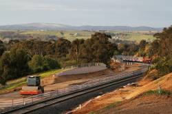 N469 and six car H set climbs out of Bacchus Marsh bound for the yard at Maddingley