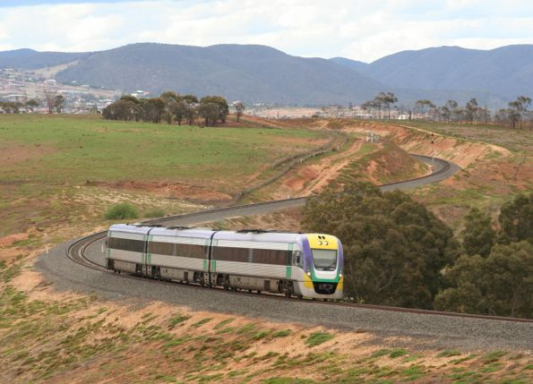 Three car VLocity rounds the Parwan curves out of Bacchus Marsh