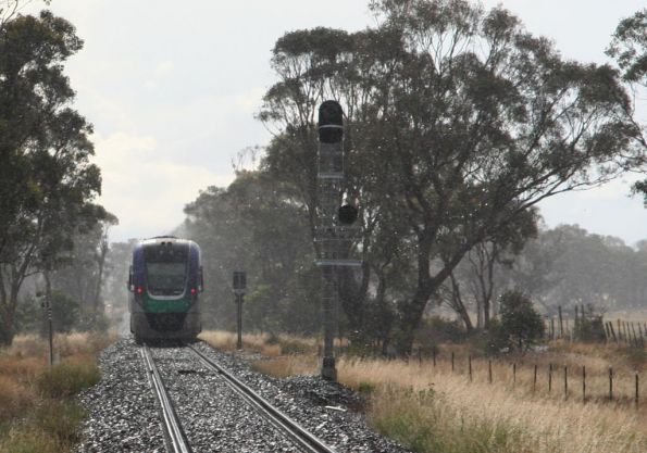 VLocity passes through Staughton Siding in the rain