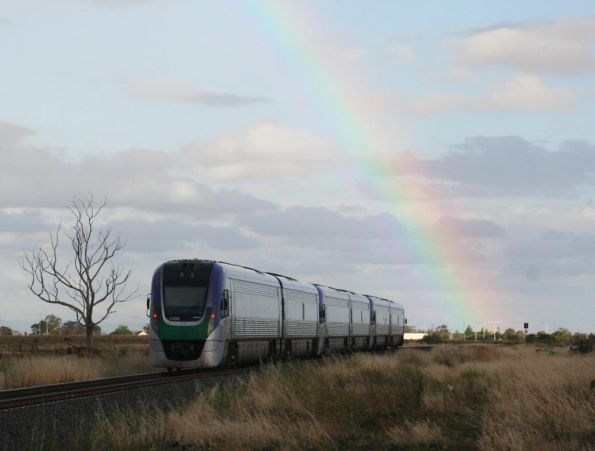 Pair of Vlocities under a rainbow at Rockbank