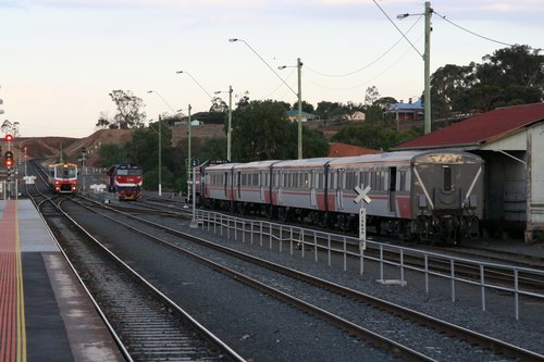 Sprinter arrives on the down, with locos waiting departure from Bacchus Marsh yard