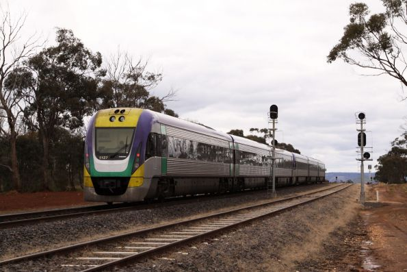 3VL37 trailing the down Ballarat service, the loop road in the foreground covered in fairy grass