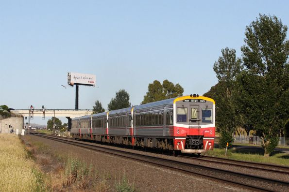 Sprinter 7021 trails a five unit lashup, at Ardeer bound for Bacchus Marsh