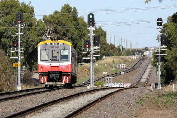 Sprinter 7015 and a single classmate climb out of the Kororoit Creek dip, bound for Melbourne