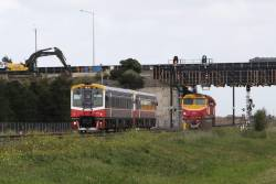Sprinter 7017 and classmate on the up pass under the Western Ring Road at Ardeer
