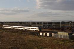 Solo VLocity train with an up Ballarat service passes the incomplete Caroline Springs station