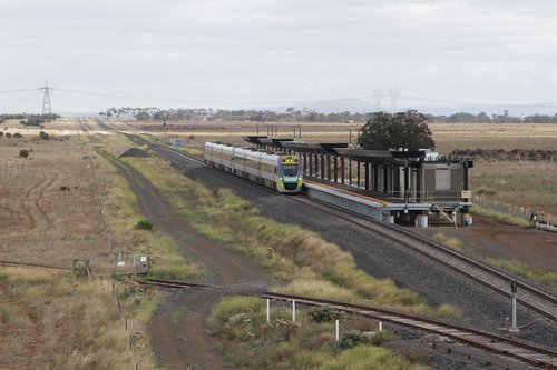 VLocity VL32 and classmate pass the future Caroline Springs station on an up Ballarat service