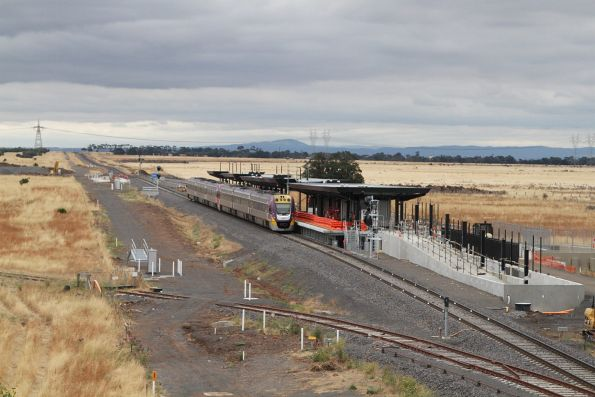 VLocity VL48 leads a classmate past the new Caroline Springs station