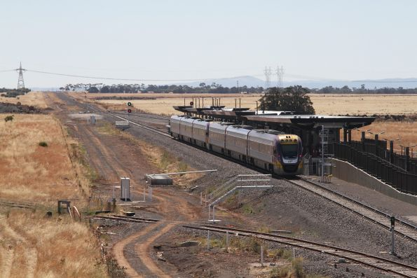 VLocity VL45 and VL09 pass the yet to be opened Caroline Springs station