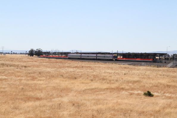Solo VLocity train passes Caroline Springs station on the down