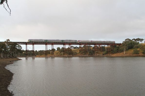 Pair of Melbourne-bound VLocity trains cross the Melton Weir viaduct