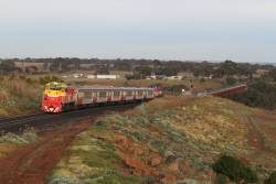 P15 leads P18 on an up push-pull train over the Melton Weir